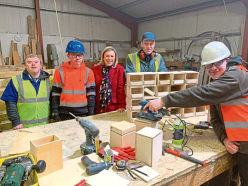 Picture of Gillian at Wood RecyclAbility. Left to Right: Neil Buchan; Kieran Thompson; Gillian Martin; Andrew Bremner; Liam McGee