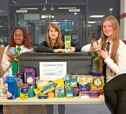 Bucksburn Academy is running a kindness campaign to encourage pupils and the community to carry out random acts of kindness. From left, Moryam Akanji, Enara Abhad, Maryanne Chapman, all 16