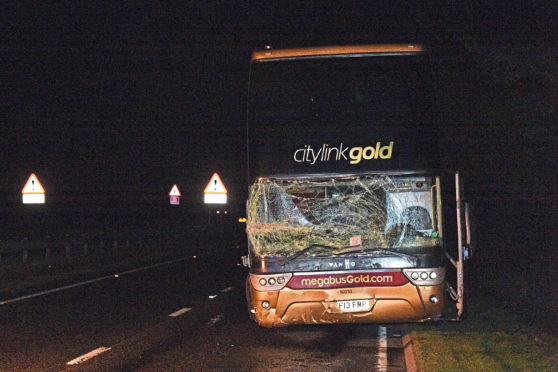 A witness told the court the car driven by the accused drove straight out into the path of a double-decker bus