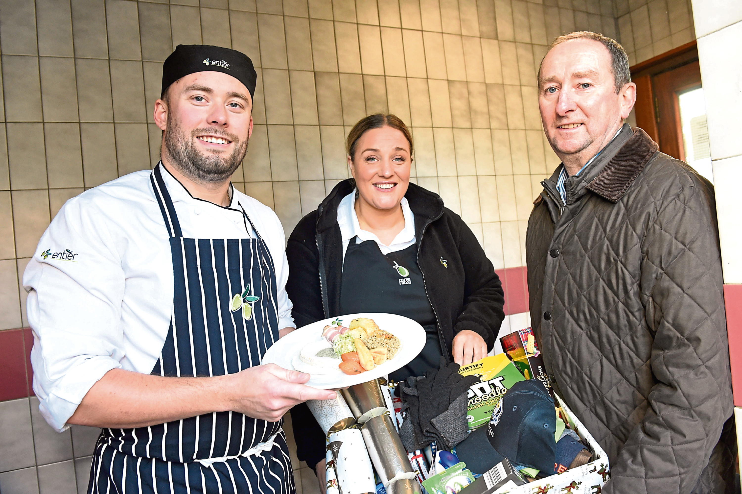 Chef Orry Shand, and Lyla Munro from catering firm Entier, which gave meals to those in need at Christmas, with Mike Burns, chief executive of Aberdeen Cyrenians.