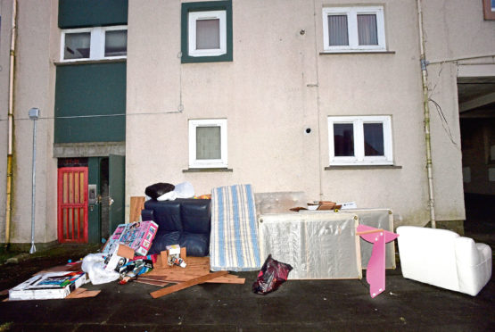 The mess outside the flats at  Fowler Avenue, Aberdeen