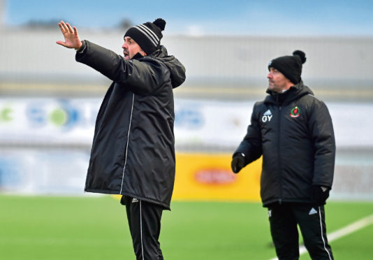 Cove Rangers manager Paul Hartley, with assistant Gordon Young.