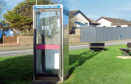 The phone box at the junction of Errolston Road and Castle Road, Cruden Bay