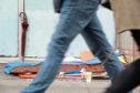 PRINCES STREET, EDINBURGH, SCOTLAND - 14 June 2019 Passersby Walking Past a Homeless Spot Outside Closedown Retail Store; Shutterstock ID 1424388782; Purchase Order: - Homelessness