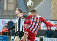 Darryn Kelly, right, wins a header. Picture by Chris Sumner