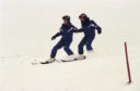 Young skiers go down the hill together in 1996