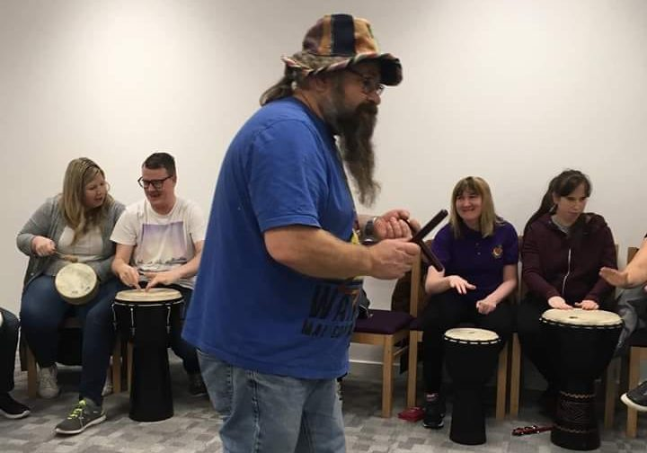 Angus McCurrach, drumming director of Huggadrum, leading a session