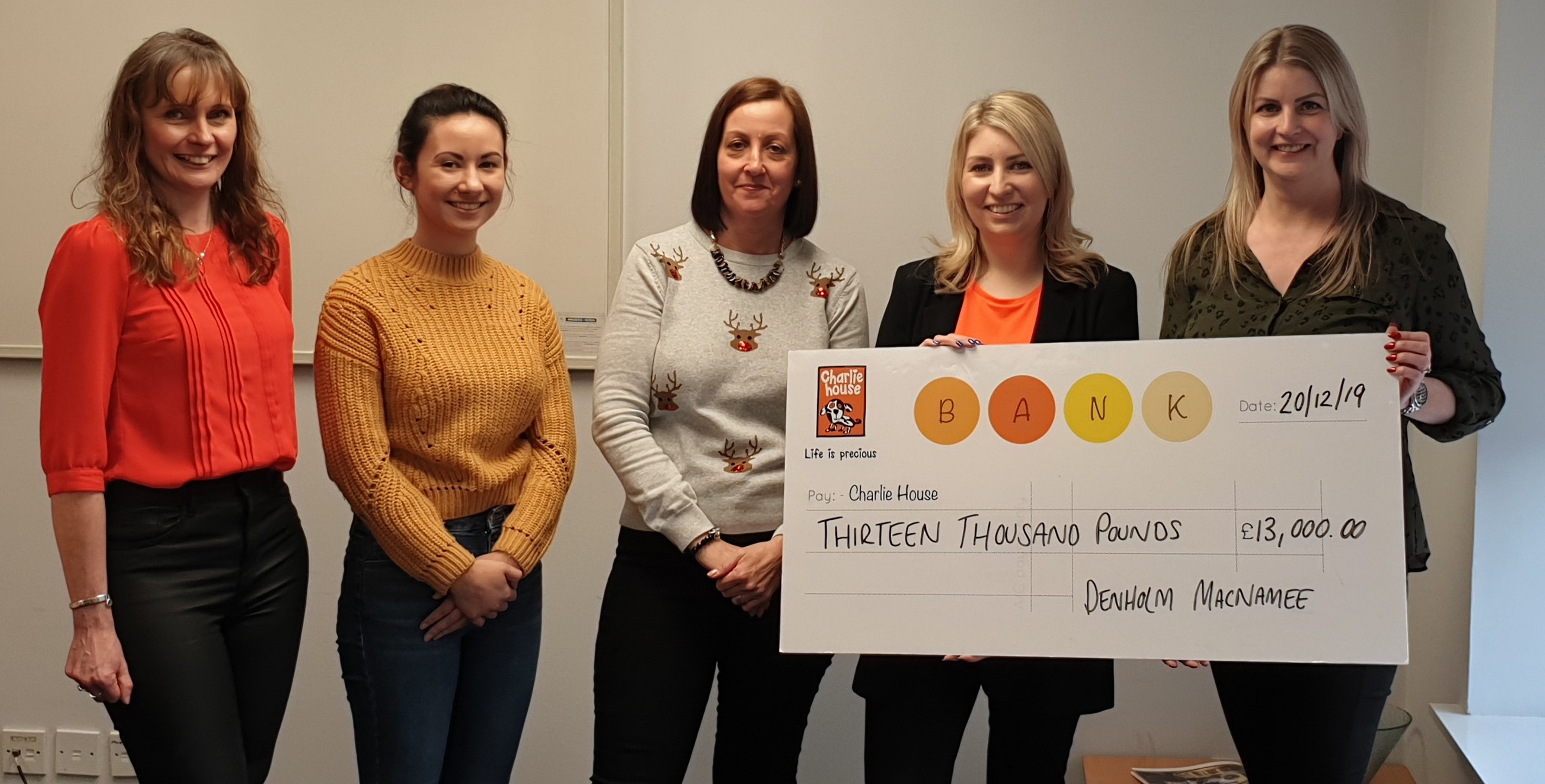 The team from Denholm MacNamee presented the cheque to Charlie House