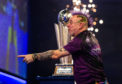 Peter Wright celebrates winning during day sixteen of the William Hill World Championships.