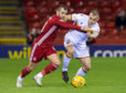 Motherwell's Liam Grimshaw (R) and Aberdeen's Niall McGinn in action during the Ladbrokes Premiership match between Aberdeen and Motherwell at Pittodrie on January 22, 2020.