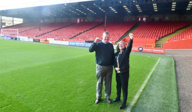 Aberdeen FC's commercial director Rob Wicks and supporter liaison officer Lynn Fiske by the Merkland Stand ahead of Saturday's Scottish Cup clash with Dumbarton. Picture by Chris Sumner