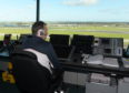 Chris Foster, a NATS air traffic controller,  working at Aberdeen International Airport