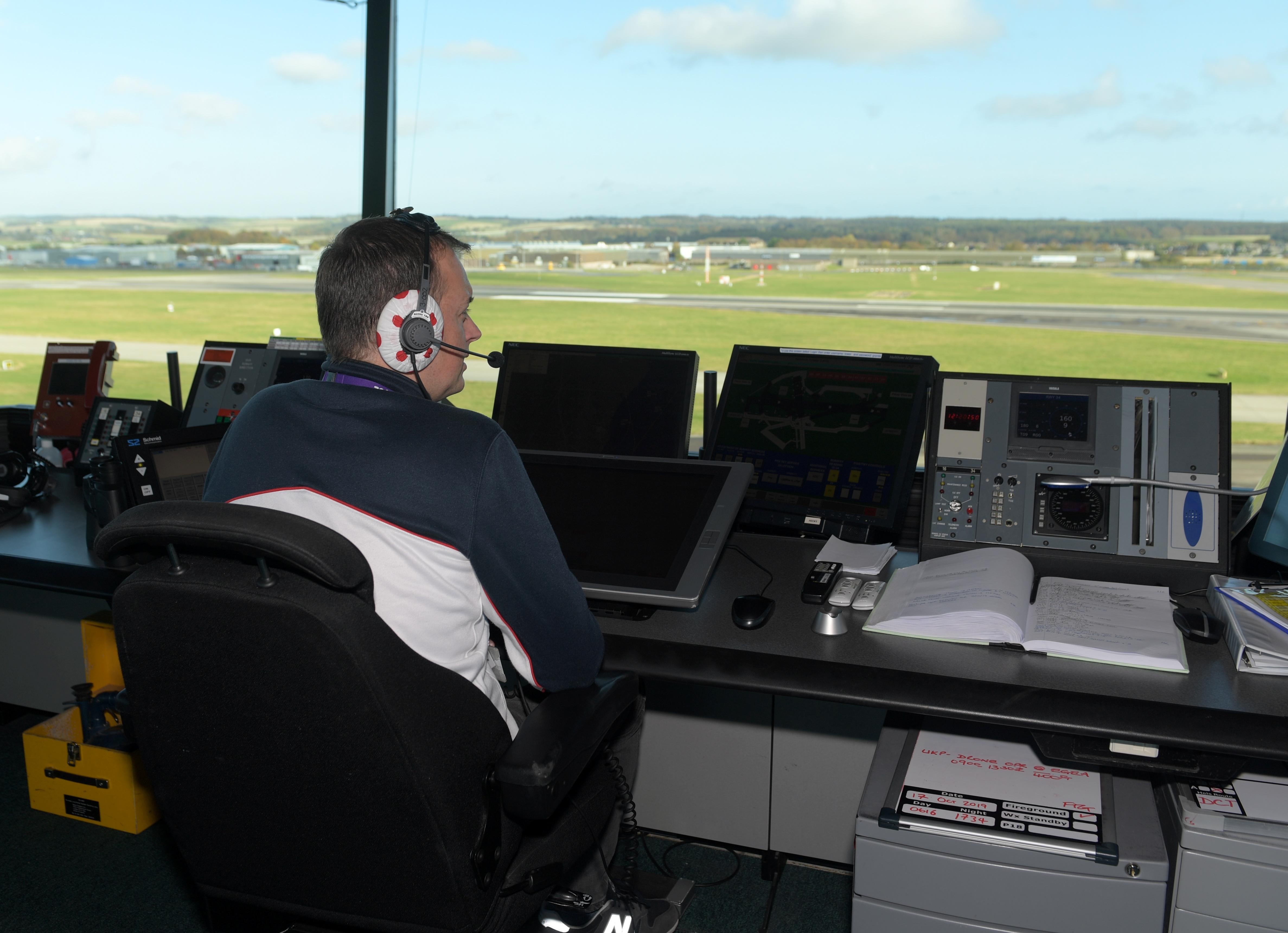 Chris Foster, a NATS air traffic controller,  working at Aberdeen International Airport