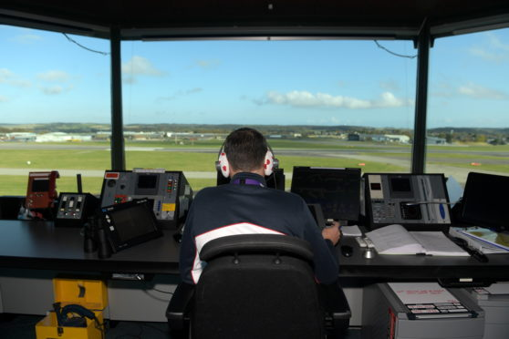 Chris Foster in the tower control room of Aberdeen Airport