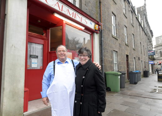 Jessica and Carmine Scarpellino outside the restaurant last year