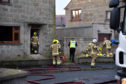 Firefighters at the scene of the blaze in Rosehearty