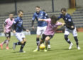 Ben Armour is surrounded by Raith defenders.