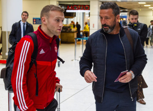 Aberdeen's new signing Dylan McGeouch with Derek McInnes at Glasgow Airport ahead of the team's January training camp in Dubai.