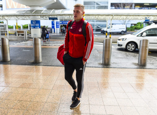Aberdeen's Sam Cosgrove at Glasgow Airport ahead of the team's January training camp in Dubai.