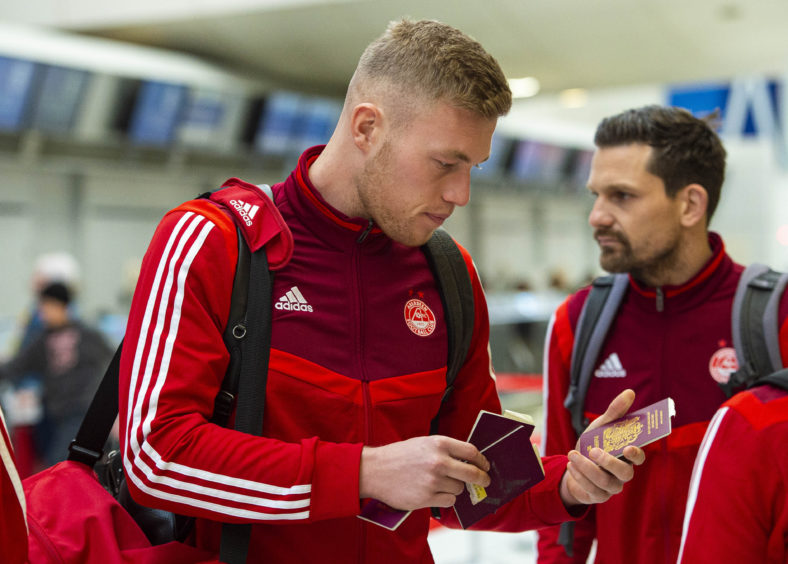 Sam Cosgrove appeared to arrive at the airport with a choice of passports.