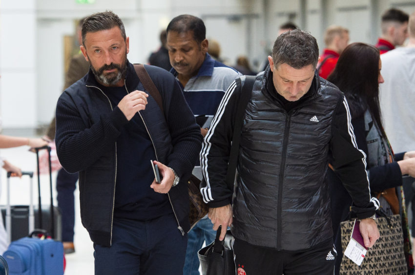 Derek McInnes with assistant Tony Docherty at Glasgow Airport.