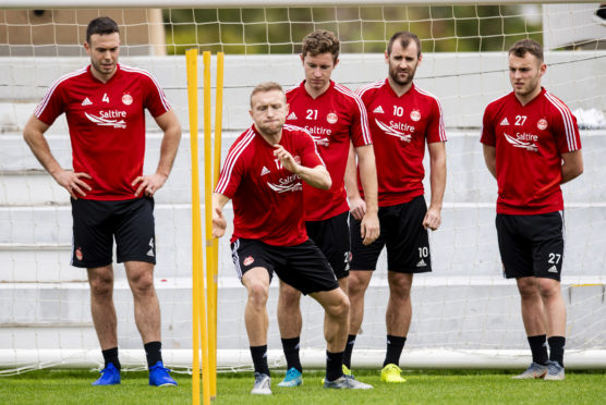 Dylan McGeouch, centre, and Jon Gallagher, behind, go through a drill in Dubai.