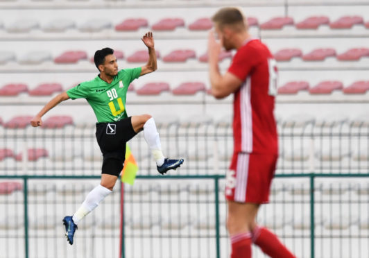Al-Wehdat's Ahmad Samer celebrates his opening goal during the friendly match.
