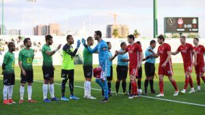 Aberdeen shake hands with Al Wehdat.