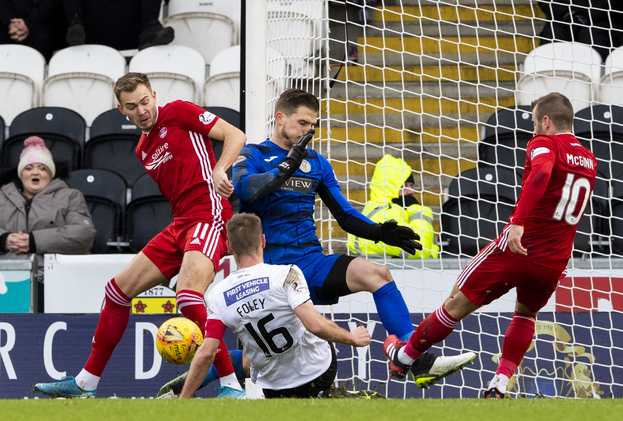 Sam Foley defends an Aberdeen chance created by Ryan Hedges and Niall McGinn, right, during the Ladbrokes Premiership match between St Mirren and Aberdeen.