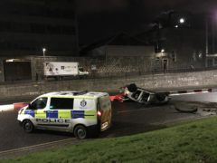 Police near Woolmanhill roundabout following a one-vehicle crash