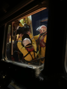 Lifeboat crews assist a casualty