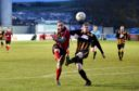 Inverurie's Jonny Smith and Huntly's Declan Milne. Picture by Colin Rennie