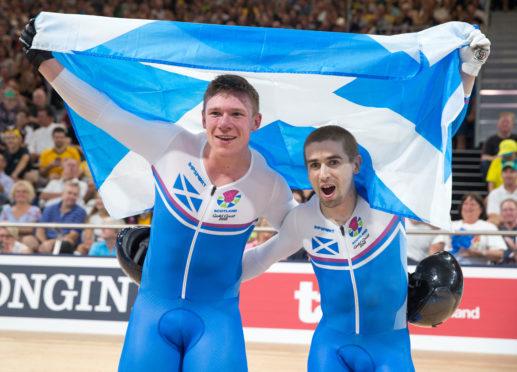 Cycling Neil Fachie and Matt Rotherham celebrate winning at Gold Coast 2018.