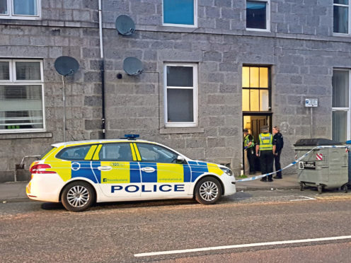 Police attending the scene of the assault on Hutcheon Street that saw a Deliveroo driver robbed while making a delivery