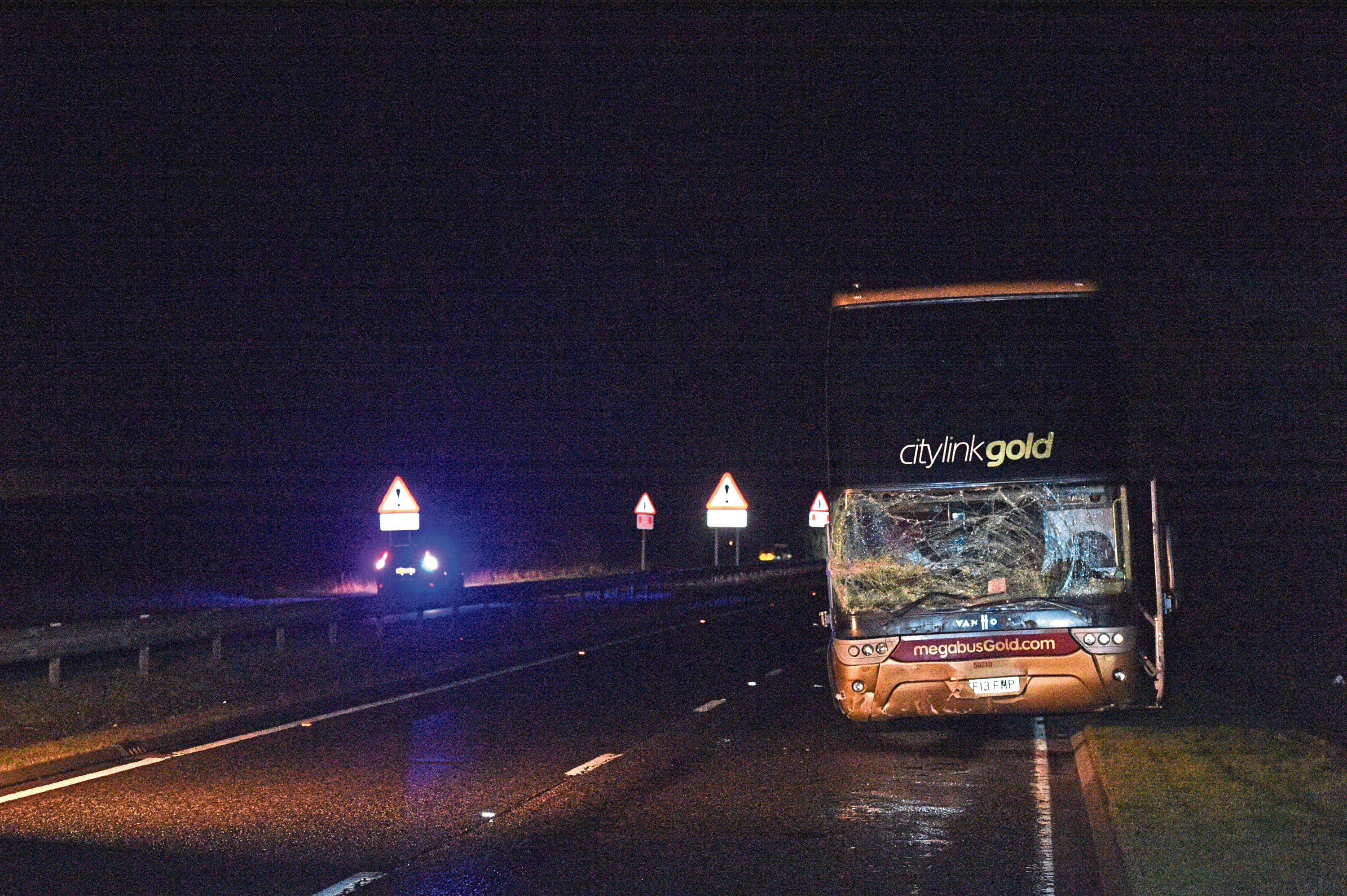 The aftermath of the crash on the A90 which killed three people