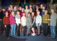 The One Voice Singers presenting Samaritans with a cheque