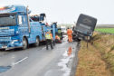 A Stagecoach bus was blown on to its side in an incident on the B9000 road near Newburgh on Saturday