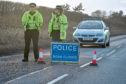 Police at the scene of the two-vehicle collision on the B9077 Kirkton of Durris to Aberdeen road