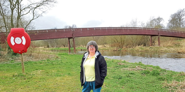 Councillor Gillian Owen at the timber footbridge in Meiklemill