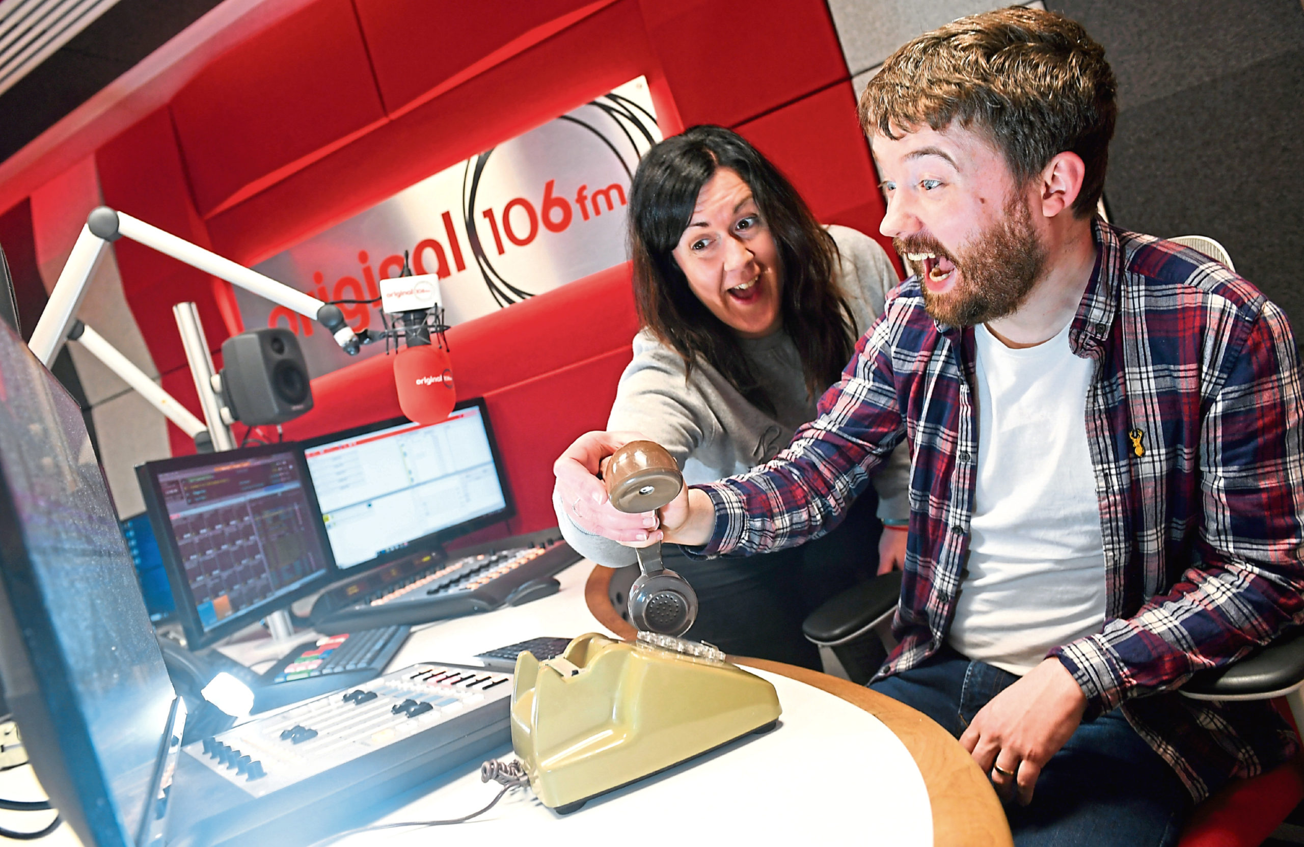 Claire Stevenson and David Lewis of the Original 106 breakfast show try to solve the mystery of the interruptions while the show was on air