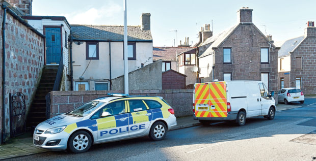 A teenager has been released after three men were injured in an incident in Peterhead