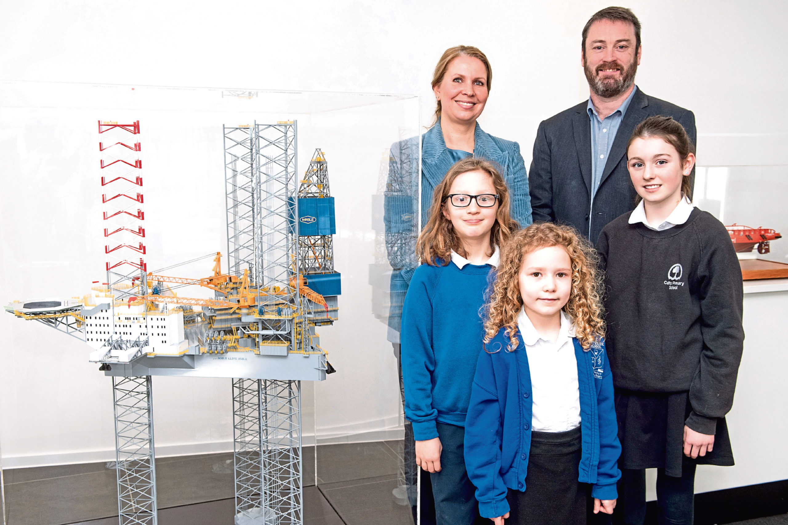 Maja Kildedal, head of innovation & improvement for Equinor UK and Ireland, and Bryan Snelling, CEO of Aberdeen Science Centre with pupils from the winning schools, Fergus Skolnik, Rowan Cuthill and Erin Macleod