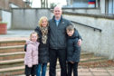 Jenny and Martin Johnston with their two children Sophie and Calum.