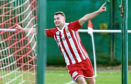 Formartine's Scott Lisle celebrates scoring. Picture by Chris Sumner