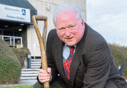 Colin Pike planting a tree for climate change