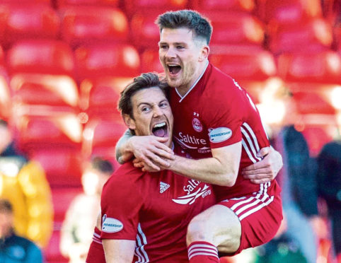 Ash Taylor celebrates with team-mate Matty Kennedy after scoring against Celtic.