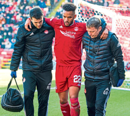 Funso Ojo is taken off with an injury during the Ladbrokes Premiership match between Aberdeen and Celtic.