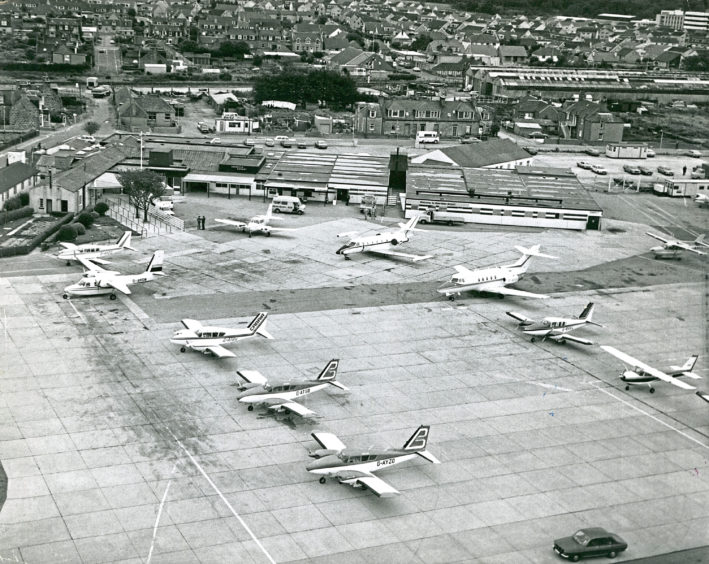 A fine collection of executive air transport parked at Aberdeen Airport in September 1977, when the Offshore Europe exhibition attracted the world's oil industry high fliers