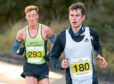 Robbie Simpson, right, and Kenny Wilson, left, during the Kinloss to Lossiemouth half marathon.