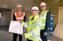 John McHardy of Robertson Eastern and councillors Jenny Laing and Douglas Lumsden with the plans